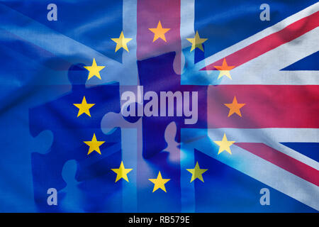 European Union and United Kingdom puzzle concept with flags of EU and Union Jack combined in full frame background gradient with two separated puzzle  - Stock Photo
