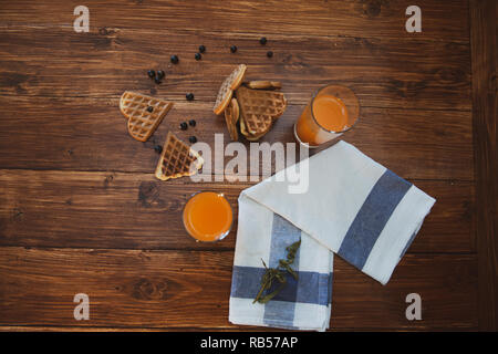 breakfast for two. freshly squeezed juice and wafers - Stock Photo