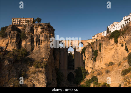 Puente Nueve bridge in Ronda, Andalucia, Spain just before sunset in late summer. - Stock Photo