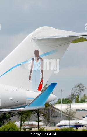 Bombardier BD-700-1A11 Global 5000 M-AJWA of  A.J. Walter (Aviation) Ltd. Private jet plane with female figure tail art. Corporate jet - Stock Photo