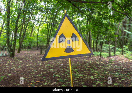A sign warning the nuclear risk in Chernobyl area in Ukraine - Stock Photo