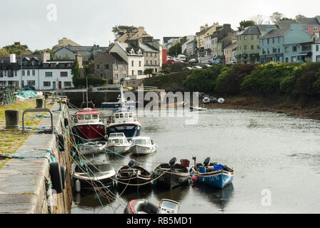 Small fishing boats at Roundstone Harbour, Co Galway, Ireland with the town behind on a summers day. - Stock Photo