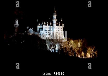 neuschwanstein castle at night in winter view - Stock Photo