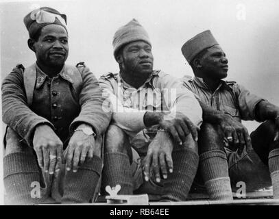 Photograph of three of members of the Free French foreign legion who distinguished themselves in the battle at Bir Hacheim in the Western desert. They are from Senegal, Equatorial Africa, and Madagascar, respectively. Dated 1942 - Stock Photo