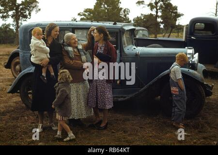 Colour photograph of young friends meeting at the Pie Town, New Mexico Fair. Dated 1940 - Stock Photo