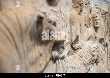 Fragment of an architectural relief showing a ritual sacrifice, Roman Empire  (Italy, Rome, 15-16 CE) on display at Louvre Abu Dhabi , UAE - Stock Photo