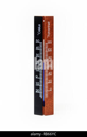 A standard wooden room thermometer, marked in degrees Celcius and Fahrenheit, showing a temperature of 22ºC/70ºF - Stock Photo