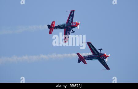 The Blades Extra EA-300s aircraft performing at the 2018 Bournemouth Air Festival - Stock Photo