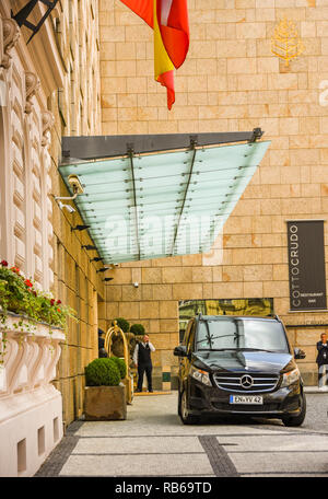 PRAGUE, CZECH REPUBLIC - JULY 2018: Entrance to the Four Seasons Hotel, Prague, with a luxury minivan parked outside. - Stock Photo