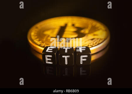 Bitcoin Exchange-traded fund ETF launch concept with coins and letters - Stock Photo