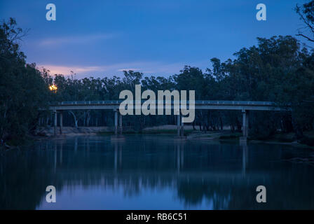 The sun just starting to rise over the Murray River, rural Australia, with cool tomes and reflections in the river - Stock Photo