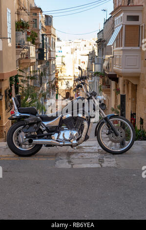 suzuki Intruder Chopper motorcycle parked in a street in Malta. - Stock Photo
