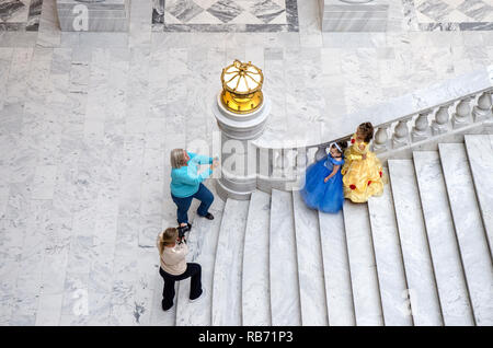 Two young girls dressed in ball gowns are photographed in the Utah State Capitol Building in Salt Lake City, Utah. - Stock Photo