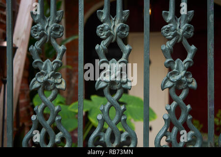 Decorative detail of wrought iron fence, French Quarter, New Orleans, Louisiana. - Stock Photo