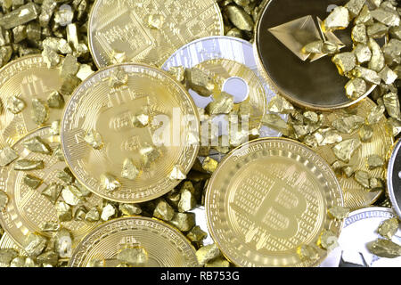 Set of cryptocurrencies with a golden bitcoin in gold nuggets. Crypto currency coins stack, Bitcoin, Ethereum, Litecoin, Ripple together in gold sand. - Stock Photo