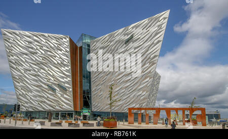 Titanic Belfast - a modern visitor centre in Belfast. People outside Titanic Belfast on a sunny day. - Stock Photo