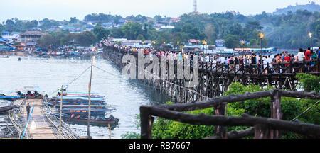 Kanchanaburi, Thailand - December 30, 2018: Tourists crowded on Saphan Mon Wooden Bridge (Mon Bridge), longest wooden bridge of Thailand during New Ye - Stock Photo