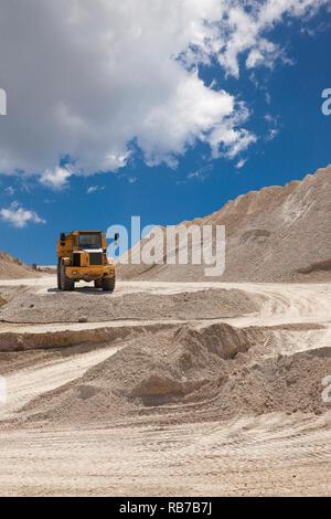 Open truck between sand hills. - Stock Photo