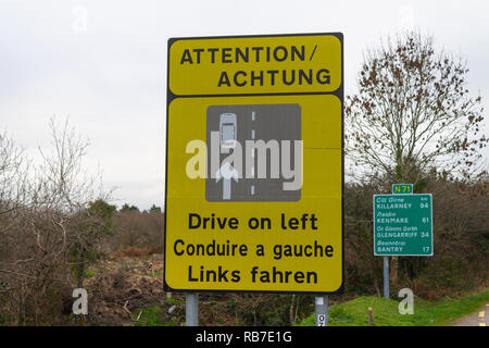 Traffic warning sign to drive on left side of the road. Ireland. - Stock Photo