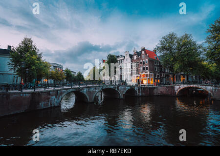 Bridge over Keizersgracht Emperor's canal in Amsterdam, dutch scene at twilight, Netherlands - Stock Photo