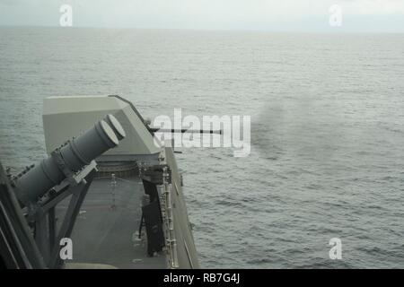 SOUTH CHINA SEA (Dec. 4, 2016) USS Coronado (LCS 4) fires a 57mm gun from bow of the ship during a live fire exercise. Currently on a rotational deployment in support of the Asia-Pacific Rebalance, Coronado is a fast and agile warship tailor-made to patrol the region's littorals and work hull-to-hull with partner navies, providing 7th Fleet with the flexible capabilities it needs now and in the future. - Stock Photo