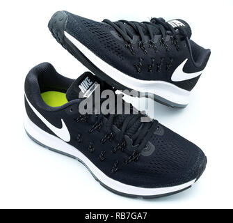 Pair of black Nike Pegasus 33 running shoes cut out isolated on white background - Stock Photo