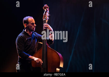 Musician playing upright double bass - Stock Photo
