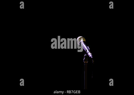 Microphone on a stand on an empty stage - Stock Photo