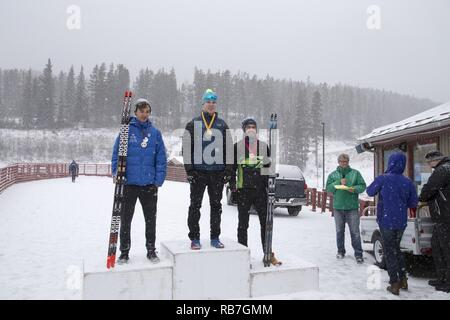 Alaska Army Guardsman Pfc. Travis Cooper, a construction equipment mechanic with the 207th Engineer Utility Detachment, claims his second gold after completing the junior men's 12.5 km mass start in the North American #1 and Calforex #1 Biathlon Cups at the Canmore Nordic Centre Provincial Park in Canmore, Alberta, Dec. 4, 2016. Cooper, 20, of Kenai, also took first place in the junior men's 10 km sprint the day before. Cooper trains year-round and competes on the National Guard Biathlon development team. - Stock Photo