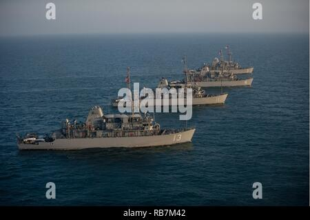 ARABIAN GULF (Dec. 6, 2016) The Avenger class mine countermeasure (MCM) ships USS Dextrous (MCM 13), USS Gladiator (MCM 11), USS Devastator (MCM 6), and USS Sentry (MCM 3), part of Commander, Task Force (CTF) 52, sail in formation as part of a photo exercise in the Arabian Gulf. The combined MCM force enhances mine-hunting capabilities in searching, identifying and neutralizing mines threatening the freedom of navigation and the free flow of commerce. - Stock Photo