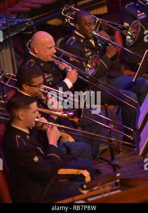 12/7/16- Spc. Samuel Dimov, Sgt. Francis Rivera-Murray, First Sgt. Charles Longfellow and Spc. Shawn Walker all play their trombone with the 287th Army Band at their annual Holiday Concert on the main stage at the Grand Opera House in Wilmington, Delaware, December 7, 2016. - Stock Photo