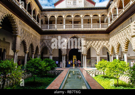 Beautiful courtyard  of Real Alcazar palace in Seville, Spain. A unesco world heritage site - Stock Photo