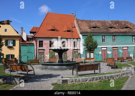 Historical old buildings in the medieval city Sibiu- Hermannstadt, Romania. Eyes in the roof - architectural detail 'The Romania Eyes'. - Stock Photo