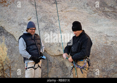 Rock climbers preparing to climb a rock in Alabama Hills near Lone Pine in Eastern Sierra Nevada, California, USA - Stock Photo