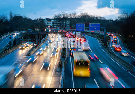 Essen, North Rhine-Westphalia, Ruhr area, Germany - Blue environmental zone, motorway A40 at the evening traffic in the city centre of Essen, here on  - Stock Photo