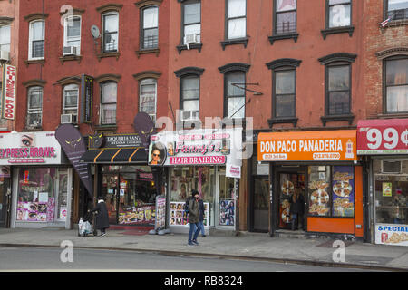 Storefronts along 3rd Avenue in East Harlem also known as Spanish Harlem and El Bario above 96th Street in Manhattan, New York City. - Stock Photo