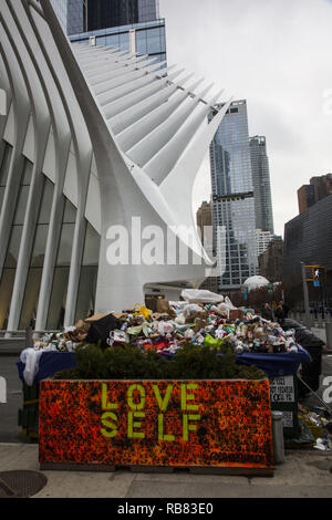 Mountains of single use coffee cups, bottles and cans piled up by passersby in a dumpster at the World Trade Center site in downtown Manhattan, New York City. - Stock Photo