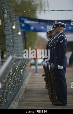 Members of the Coast Guard Ceremonial Honor Guard stand at parade rest during the Pearl Harbor Remembrance ceremony on Coast Guard cutter Taney in Baltimore Wednesday, Dec. 7, 2016. This year marks the 75th anniversary of the attack on Pearl Harbor. - Stock Photo