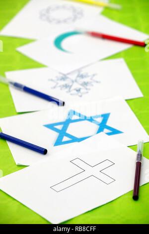 Symboles interreligieux. Interfaith dialogue. Symbols of islam, judaïsm and christianity. Annecy. France. - Stock Photo