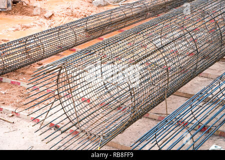 Reinforcement rebar cages for poles construction at construction site - Stock Photo