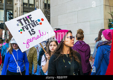 Chicago, IL, United States - January 21, 2017: Girl holds a picket sign that reads 'The Future Is Female' during Women's March in Chicago on January 2 - Stock Photo
