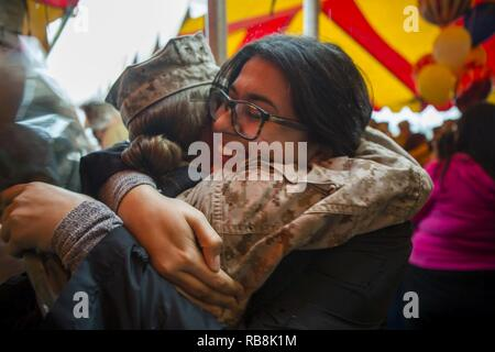 Friends and family of Marines and Sailors with Special Purpose Marine Air-Ground Task Force-Crisis Response-Central Command wait for their return from deployment at Marine Corps Base Camp Pendleton, Calif., Dec. 16, 2016. - Stock Photo