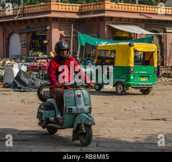 Jodhpur, India - Nov 6, 2017. A man riding Vespa on street in Jodhpur, India. Jodhpur is the second largest city in state of Rajasthan. - Stock Photo