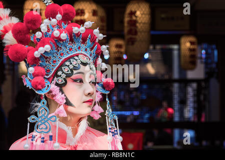 Chengdu, Sichuan Province, China - Nov 18, 2018 : Portrait of a yound woman dressed in Sichuan Opera traditional costume in Jinli street touristic area. - Stock Photo