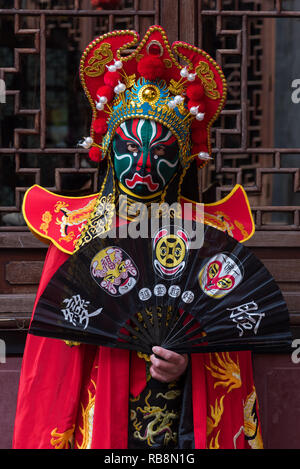 Chengdu, Sichuan Province, China - Nov 18, 2018 : Portrait of a yound man dressed in Sichuan Opera traditional costume in Jinli street touristic area. - Stock Photo