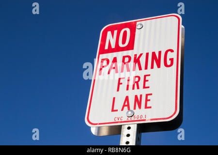 The 'No parking fire lane' sign. - Stock Photo