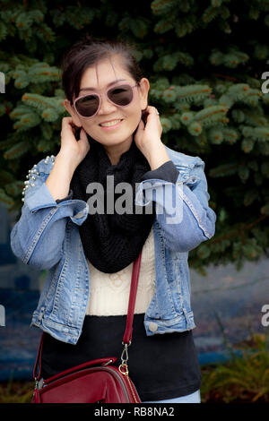 asian woman toothy smiling face with happiness emotion - Stock Photo
