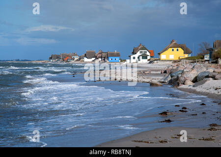 Colorful beach houses in Heiligenhafen at the Baltic Sea - Stock Photo