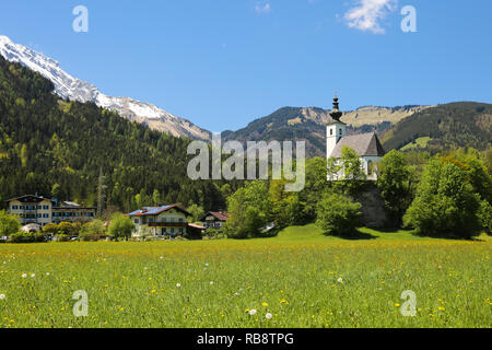 Lonely church in a small mountain village - Stock Photo