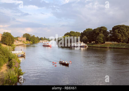Boats on the River Thames at Hampton Court on a lovely summer's evening, East Molesey, Surrey, Greater London, England, UK - Stock Photo